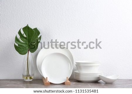 Set of new ceramic dishware on table