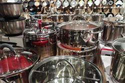 set of new metal pots cookware in a shop