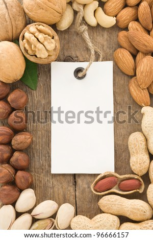 set of nuts fruit and tag label on wood background texture