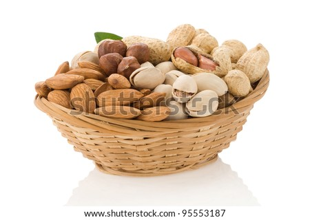 set of nuts in bowl isolated on white background