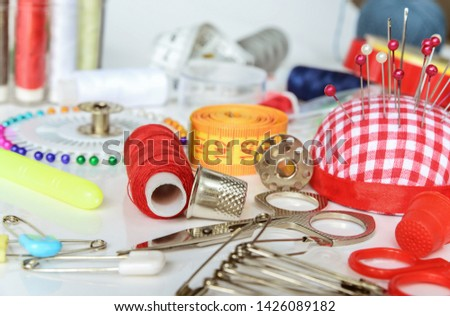 Set of objects for needlework: threads, needles, pins, scissors, beads, centimeter tape etc.