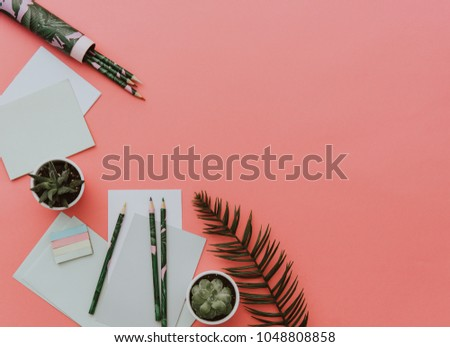 Set of office supplies flat lay. Top view on various stationery with green plants and leaf on desk. Creative workspace background