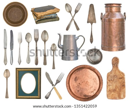Set of old and wooden items. Silverware, kitchen accessories. spoons, forks, books, milk can, teapot, picture frames, board  isolated on white background.