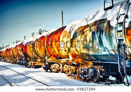 Set of old tanks with oil and fuel transport by rail in winter