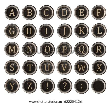 Set of old typewriter keys with alphabet on it isolated on white background