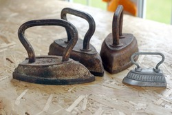 Set of old vintage cast iron and steel irons