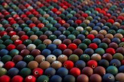 Set of opaque and many-coloured beads looking like mini Christmas balls. Seed beads for use in necklaces and bracelets.