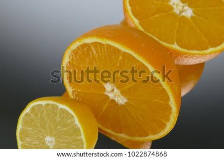 Set of orange fruits, Slice of fresh oranges against on mirror grey background. #1022874868