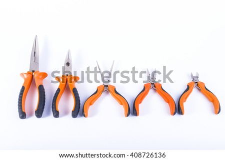 Set of orange pliers, isolated #408726136
