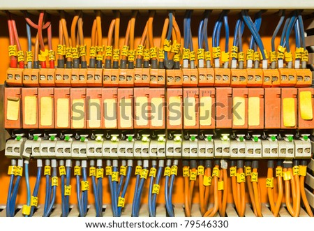 Set of Orange terminal blocks located inside of a control panel