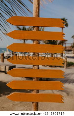 set of orange wooden arrow pointers- Image  #1341801719