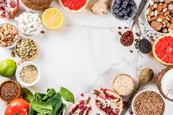Set of organic healthy diet food, superfoods - beans, legumes, nuts, seeds, greens, fruit and vegetables.. white background copy space. top view frame