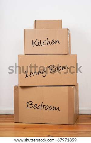 Set of package labeled Kitchen, Living Room and Bedroom. Ready for moving day.