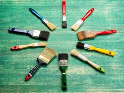 Set of paint brush on wooden background top view