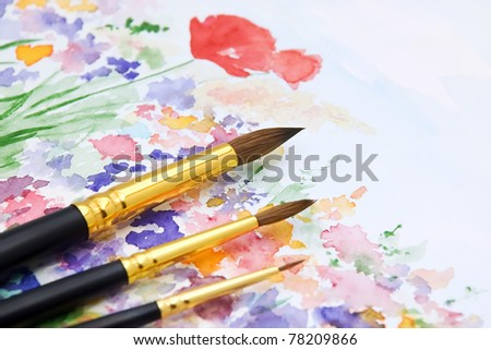 Set of Paint Brushes on Hand Drawn and Painted Watercolor Background