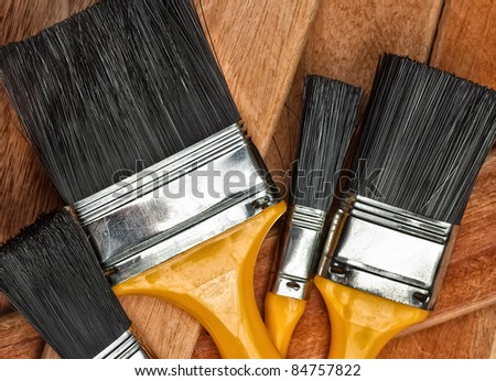 Set of paint brushes on wooden boards