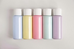 Set of 5 paint trendy colors: pink, violet, blue sky, green, yellow. Acrylic paints in cans pastel colors, horizontal photography.