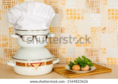 Set of pans with eyeglasses like joke caricature of a cook