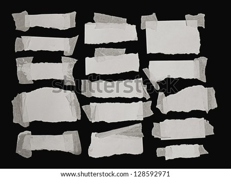 set of paper notes isolated on black background
