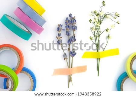 Set of paper sticky tape on a white background. Colored self-adhesive tape for decoration. Decorative adhesive tape for hobby. Small bouquet of dry lavender and gypsophila glued to paper, herbarium