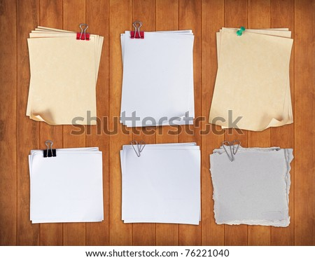 set of paper with clip over wood pane