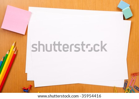 Set of pencils, erasers, post-its and other useful supplies for the school. There is a centered blank sheet for text writing