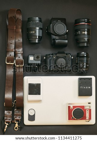 Set of photographer for travel. The layout of the cameras. My set of photo equipment. Notebook. #1134411275