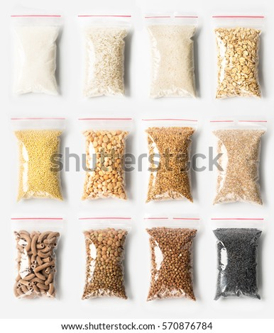 Set of Plastic transparent zipper bags with full of premium groats isolated on white, Vacuum packages with pasta, peas, groats, rice, seeds, semolina, sugar, flakes. Concept #570876784