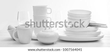 Set of plates and cutleries on light background #1007564041