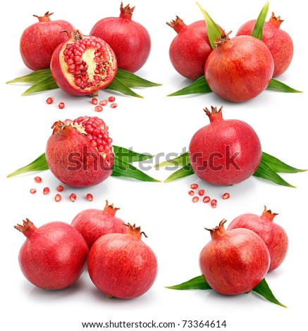 Set of pomegranate fruits with green leaf and cuts isolated on white background
