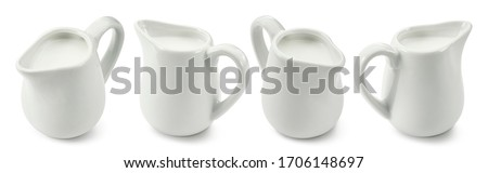 Set of porcelain ceramic milk jars or creamers isolated on white background. Package design element with clipping path