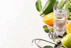 Set of products for diet food with medical Stethoscope and water on on white background. Healthy lifestyle concept