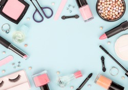 set of professional decorative cosmetics, makeup tools and accessory on blue background with copy space for your text. beauty, fashion, party and shopping concept. flat lay frame composition, top view