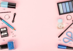 set of professional decorative cosmetics, makeup tools and accessory on pink background with copy space for your text. beauty and fashion concept. flat lay frame composition, top view