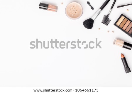 set of professional decorative cosmetics, makeup tools and accessory on white background with copy space for text. beauty, fashion, party and shopping concept. flat lay composition, top view #1064661173