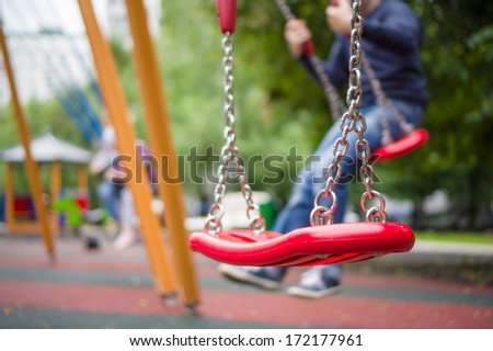 Set of red chain swings on modern kids playground #172177961