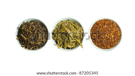Set of red, green and black dry tea, isolated on white