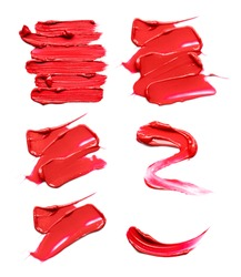 Set of red lipstick smears or acrylic paint isolated on white background.