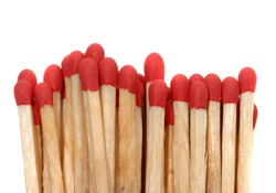 Set of red matches close up on white background