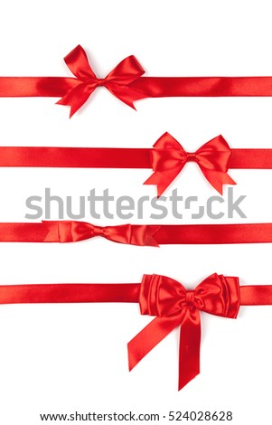 set of red ribbon satin bows isolated on white