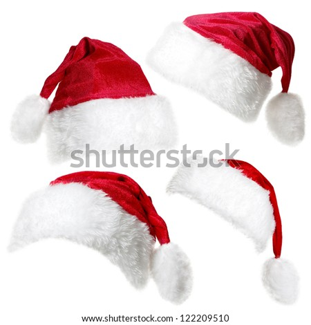 Set of  red Santa Claus caps isolated on a white background - stock photo