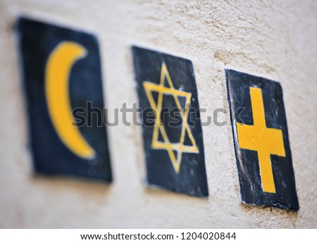 Set of 3 religious symbols: islamic crescent, jewish David's star, christian cross (wall sign on the street of Segovia, Spain)  #1204020844