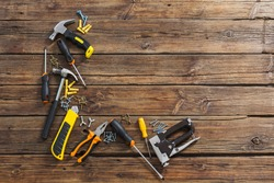 set of repair tools on old wooden background