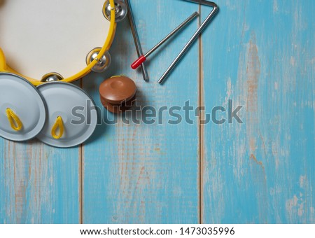 Set of rhythm tambourine, metronome,cymbals on wood table,Music festival and study and school advertising concept. #1473035996