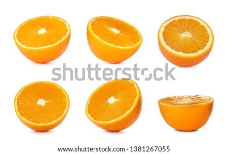 Set of ripe juicy oranges on white background