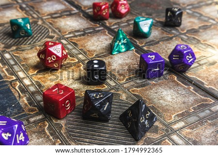 Photo of  Set of role playing dice on a gaming mat.