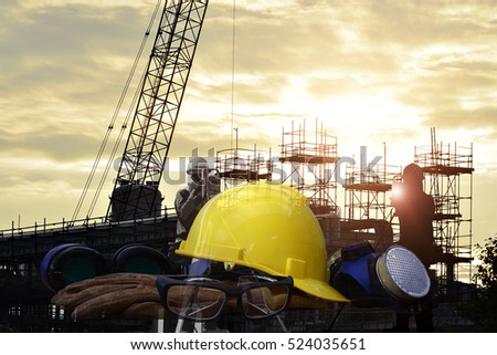 Set of safety work wear on  construction background ,Work safety at construction site concept .