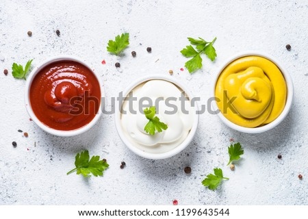 Set of sauces - ketchup, mayonnaise and mustard on white background. Top view. #1199643544