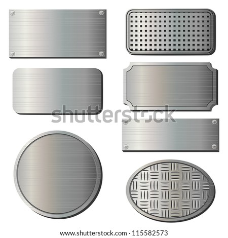 Set of seven gray metal plates over white