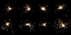 Set of 8 shots of sparklers isolated on black background; usefull in overlay design; fire sparks particles on black background
